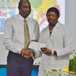 Derrick 'Rah' Peters (right) receiving the award from LIME's country manager of LIME;  Jeffery Baptiste