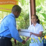 Education Minister Petter Saint Jean presenting the iPad to Louise Aarons