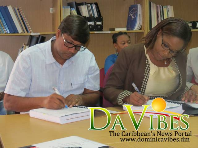 Jacques Gaddarkhan and Carleen Roberts of the National Authorizing Office for the European Development Fund signing the contract on Friday