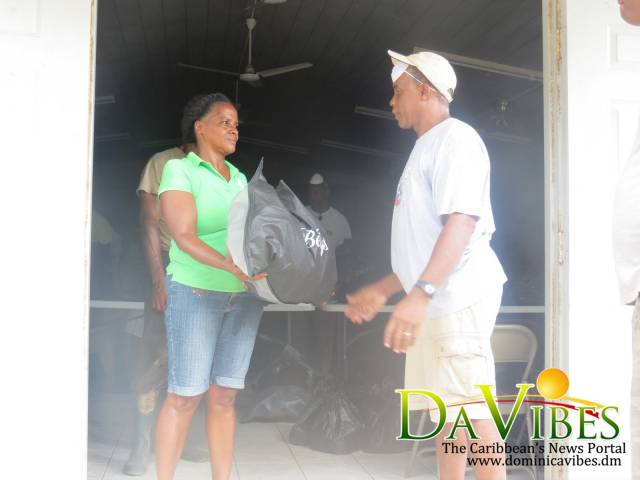 Assistant Pastor Isidor Douglas Present elder at the Coulibistrie church with a package
