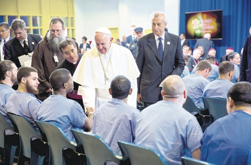 PHILADELPHIA, USA — Pope Francis greets inmates during his visit to Curran-Fromhold Correctional Facility in Philadelphia yesterday. (PHOTO: AP)