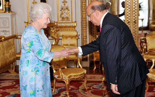 The Queen shakes hands with Sir Ronald Sanders at Buckingham Palace in 2010  Photo: PA
