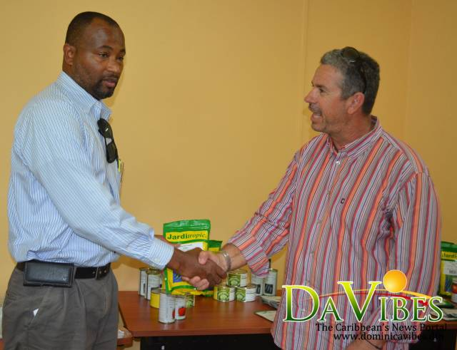 Felix Leslie (left) Technical Officer extension receiving seeds from Patrick Seinouret Manager of SCIC Guadeloupe.