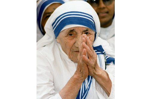 In this file photograph taken on May 15, 1997, Mother Teresa greets people at the Missionaries of Charity For Destitute Children in New Delhi.