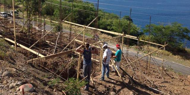 Adventist volunteers building a new home for a family on the island of Dominica. (Henry Peters / IAD)