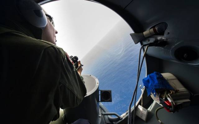 A French soldier aboard an aircraft searching in May for debris from the crashed EgyptAir Flight 804 over the Mediterranean Sea. Credit Alexandre Groyer/French Navy, via Agence France-Presse — Getty Images