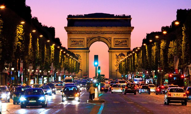 The Arc de Triomphe and Champs Élysées in Paris at night. Visitors to the arch fell more than a third in the first half of 2016 from the same period last year. Photograph: Alamy