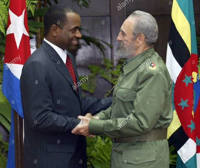 Cuban President Fidel Castro (R) shakes hands with Dominica's Prime Minister Roosvelt Skerrit (L) during a meeting on Friday, 18 February 2005 in Havana City, Cuba. (Photo credit: Alamy)