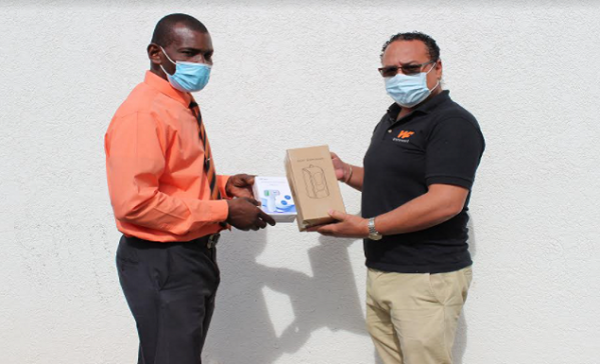 Two Local Businessmen Donates Face Masks and Other Covid-19 Products to the Ministry of Education